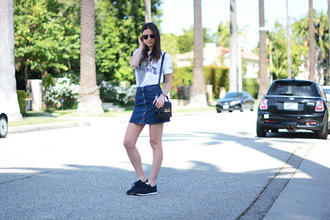 fashion vibe blogger graphic tee denim skirt black sneakers