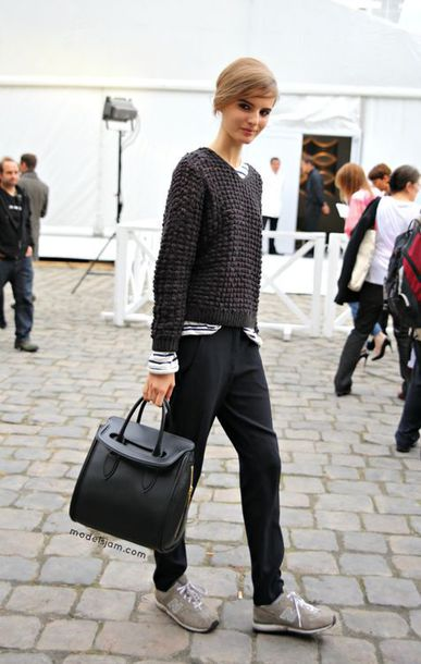 black pants, trainers, sweater