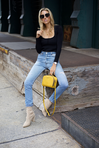 mindbodyswag blogger top jeans shoes bag sunglasses high waisted jeans boots yellow bag black top fall outfits