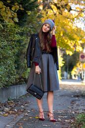 the fashion fraction,blogger,belt,bag,jewels,midi skirt,circle skirt,grey skirt,pom pom beanie,perfecto,red heels,studded shoes