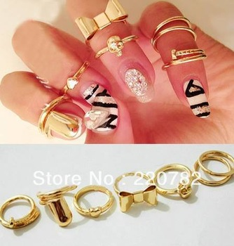 Min order is $10 7Pcs Punk Promotion Gold Color Skull Bowknot Heart Nail Simple Band Mid Finger Top Stacking Rings Set for Women-in Rings from Jewelry on Aliexpress.com