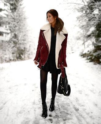 stylista blogger shearling jacket winter coat winter outfits little black dress leather bag