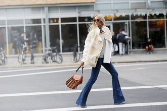 the fashion guitar blogger flare jeans fringed bag