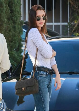 top bella hadid white top celebrity style celebrity model bag chanel bag chanel green bag belt black belt jeans blue jeans long sleeves sunglasses rayban