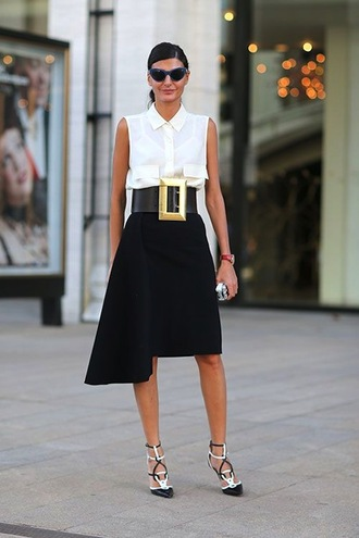 skirt work outfits office outfits midi skirt streetstyle black skirt asymmetrical asymmetrical skirt black white shirt sleeveless sleeveless shirt white shirt waist belt belt black belt sunglasses high heels shoes caged sandals sandals sandal heels high heel sandals spring outfits ny fashion week 2016