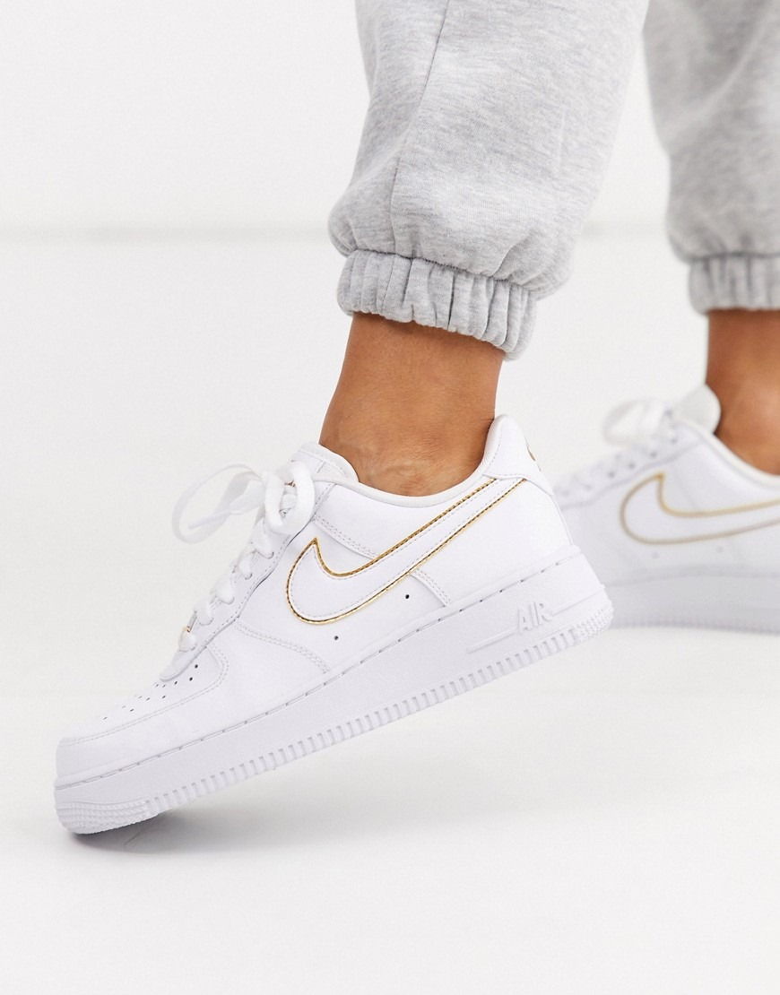 Nike white and gold Air Force 1 '07 sneakers