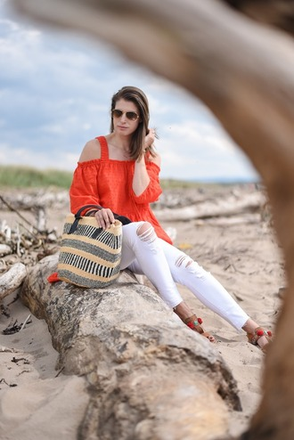 thank fifi blogger shoes bag jewels coat off the shoulder white jeans ripped jeans aviator sunglasses long sleeves orange