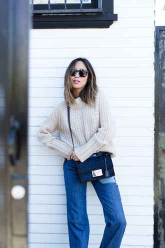 song of style blogger beige sweater oversized turtleneck sweater flare jeans patched denim fall outfits