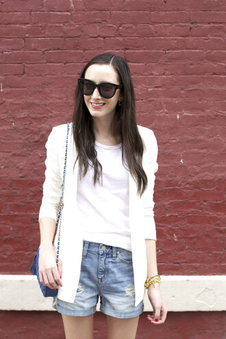 the glam files blogger white blazer black sunglasses denim shorts