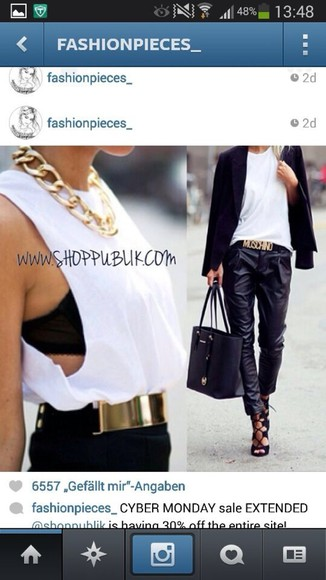 black bag tank top white trousers belt