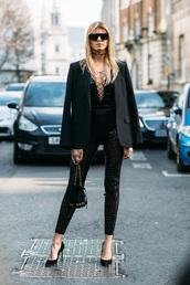 jumpsuit,london fashion week 2017,fashion week 2017,fashion week,streetstyle,black jumpsuit,lace up,bag,mini bag,bucket bag,pumps,pointed toe pumps,high heel pumps,black heels,black blazer,blazer,all black everything,sunglasses,choker necklace,black choker,necklace