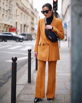 bag sunglasses blazer orange blazer orange pants pants supreme fanny pack pantsuit power suit
