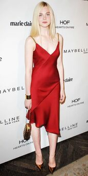 dress,red slip dress,slip dress,asymmetrical dress,red dress,summer dress,cocktail dress,pointed toe pumps,pumps,gold pumps,clutch,metallic clutch,elle fanning,celebrity