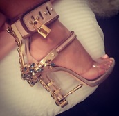 shoes,beige shoes,jewels,open toes,bullet,crystal,clear strap,dsquared,heels with rhinestones,dsquared2,high heels,gemstone,rhinestones,gold heels,style,stilletoes,heels color pumps wedges sexy,nude pumps,sexy pumps,prom shoes,nude heels,ankle strap heels,heels,diamonds,chain,tan,lock,nude,nude high heels,sparkle,charms,gold