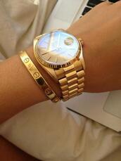jewels,watch,bracelets,hat,gold bracelet,cartier,women,jewelry,stacked bracelets,gold,rolex
