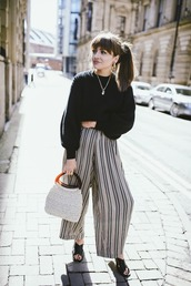 shoes,black sweater,sweater,bag,handbag,sandals,black sandals,necklace,wide-leg pants