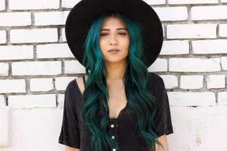 the river wolf blogger hat black hat green hair