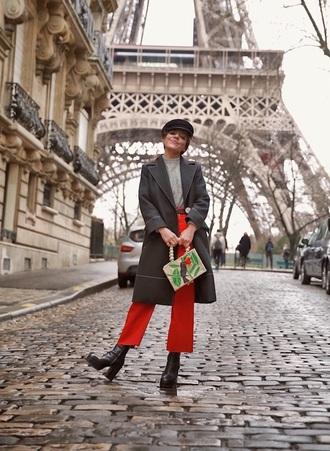 hat fisherman cap pants red pants cropped pants culottes coat black coat top grey top boots