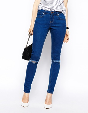 ASOS | ASOS Whitby Low Rise Skinny Jeans in Rich Dark Wash Blue With Ripped Knees at ASOS