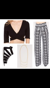 pants,bohemian,boho,baggy pants,crop tops,black long sleeve crop top,cut-out,gladiators,flat sandals,black sandals,sandals,gold chain,tribal pattern,ethnic pattern,patterned pants,shirt,shoes,jewels