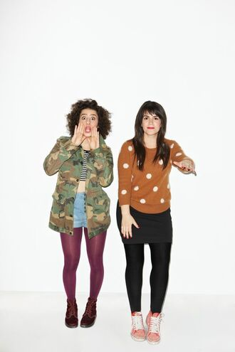 jacket ilana glazer abbi jacobson celebrity actress tights shorts denim shorts blue shorts skirt black skirt mini skirt sweater brown sweater polka dots top striped top crop tops army green jacket army print sneakers red sneakers boots flat boots brown boots