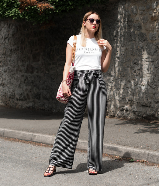t-shirt wide-leg pants striped pants studded sandals tote bag sunglasses blogger blogger style slogan t-shirts