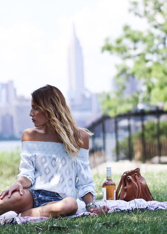 the marcy stop blogger blouse shorts bag shoes off the shoulder white top long sleeves denim shorts brown bag fringed bag date outfit summer outfits white off shoulder top off the shoulder top