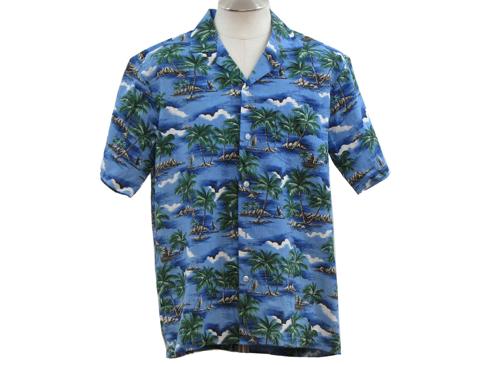 Mens shades of blue, green, taupe, beige, black and white cotton and polyester short sleeve hawaiian shirt. water, mountains, palm trees and huts print with left chest pocket, fold over collar and button front closure.