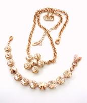 jewels,swarovksi,swarovski necklace,swarovski crystal jewelry,swarovski pendant,swarovski rose gold,swarovski silk necklace,silk rhinestones,silk bling,light peach necklace,siggysbeads,pendant,flower pendant,daisy pendant,bling,bling jewelry,trendy,trendy jewelry,fancy pendant,fancy necklace,fancy daisy pendant,rose gold,siggyjewelry,statement necklace,wedding jewelry,gifts for mom,gifts for her,elegant crystal jewelry,sabika inspired,mariana inspired,affordable bling,swarovski jewelry