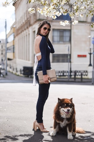 thank fifi blogger bag open back long sleeves blue top skinny jeans black jeans thick heel nude heels clutch