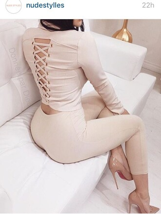backless beige nude back turtleneck pink long sleeves lace up pink top nude top white pants open back