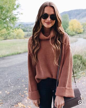 sweater pink sweater pants blue pants handbag brown handbag sunglasses black sunglasses bag
