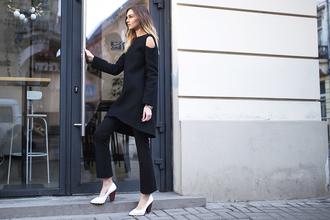 fashion agony blogger dress pants shoes bag jewels cut out shoulder dress over pants black pants black dress pumps white heels