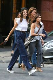 pants,kaia gerber,jeans,denim pants,high waisted,flare jeans,blue jeans,casual