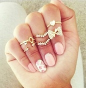 jewels,ring,jewelry,bows,knuckle ring,ring stack,stacking ring,accessories,boho jewelry,chic jewelry,dainty jewelry,fashionista,must-have,stat,stacking rings,bow,infinity,girly