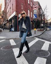coat,knee high boots,jeans,crossbody bag,chanel bag,long sleeves,top,black sunglasses,winter outfits