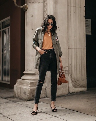 jacket top orange top jeans black jeans shoes flats sunglasses bag parka green jacket army green jacket army green handbag