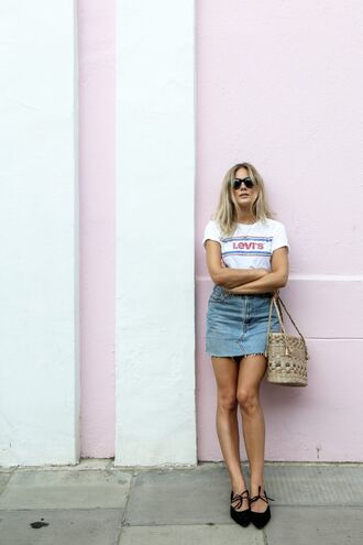 skirt fashion me now blogger ripped mini skirt denim skirt graphic tee raffia bag strappy flats frayed denim skirt frayed denim summer outfits levi's bag