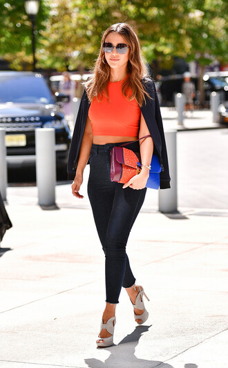 shoes celebrity style sandals sandal heels high heel sandals jessica alba crop tops top orange orange top jacket black jacket jeans blue jeans sunglasses celebrity clutch