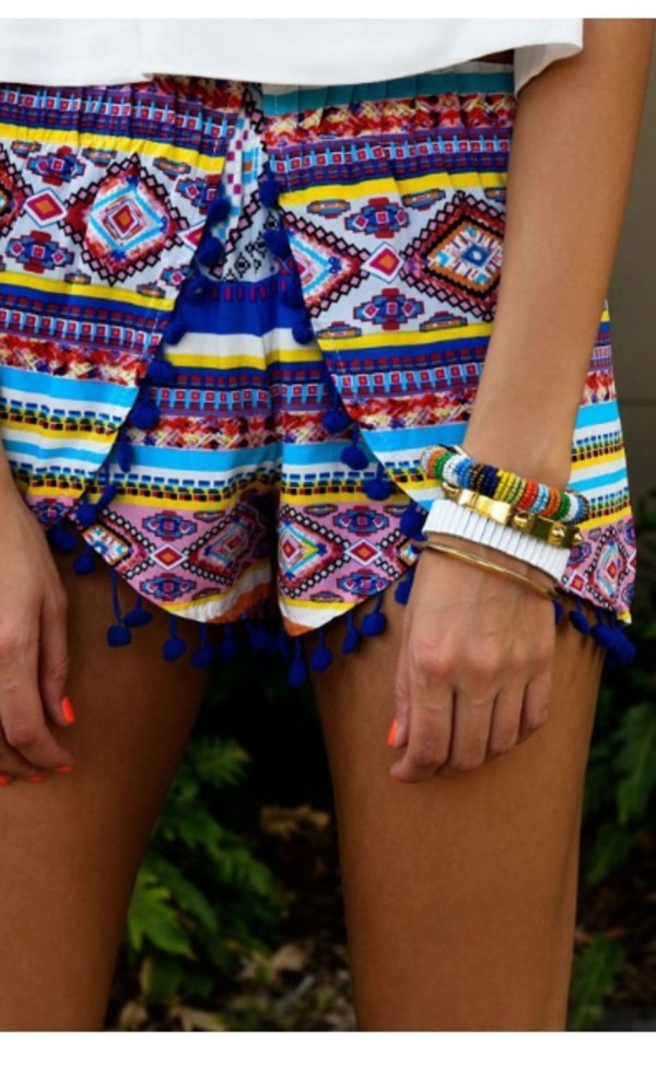 aztec shorts summer outfits collors tanned girl pom pom shorts blue yellow nail polish bracelets