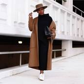 coat,brown coat,white sneakers,black pants,black sweater,felt hat,black bag
