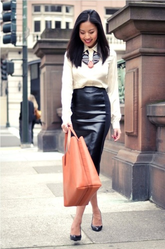 skirt white shirt statement necklace black leather skirt coral bag black stilettos