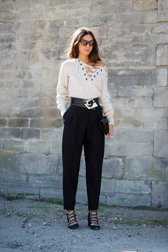 blouse paris fashion week sweater pants black pants heels black heels belt fashion vibe street fashion style cream cream sweater strappy strappy heels cute style sunglasses black sunglasses lace up lace up jumper