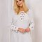 White plunge neck lace up front long sleeve knit dress