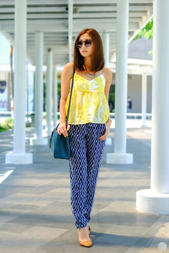 kryzuy blogger sunglasses printed pants yellow top shoulder bag ballet flats spring