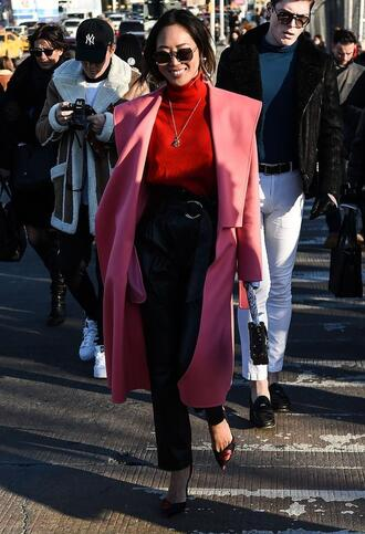 coat nyfw 2017 fashion week 2017 fashion week streetstyle pink coat waterfall coat sweater red sweater turtleneck necklace jewels jewelry sunglasses pants black pants baggy pants black leather pants leather pants pumps pointed toe pumps high heel pumps