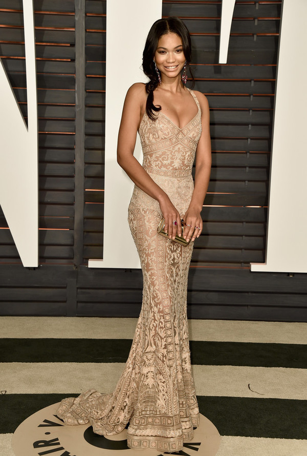 dress gown lace lace dress chanel iman oscars 2015 red carpet dress hair accessory jewels wedding dress tan brown chanel iman wore it . celebrity gold