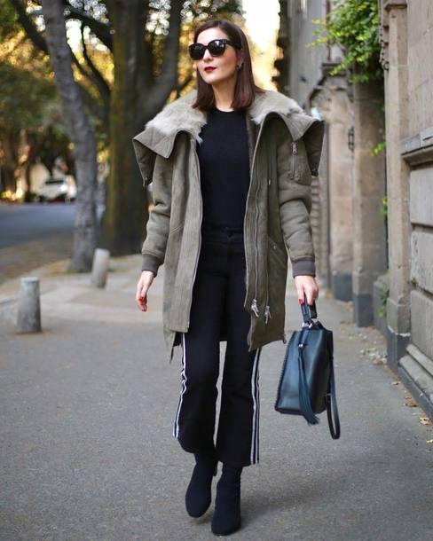 coat tumblr army green color parka winter outfits winter coat sweater pants black pants cropped pants boots black boots sunglasses bag black bag
