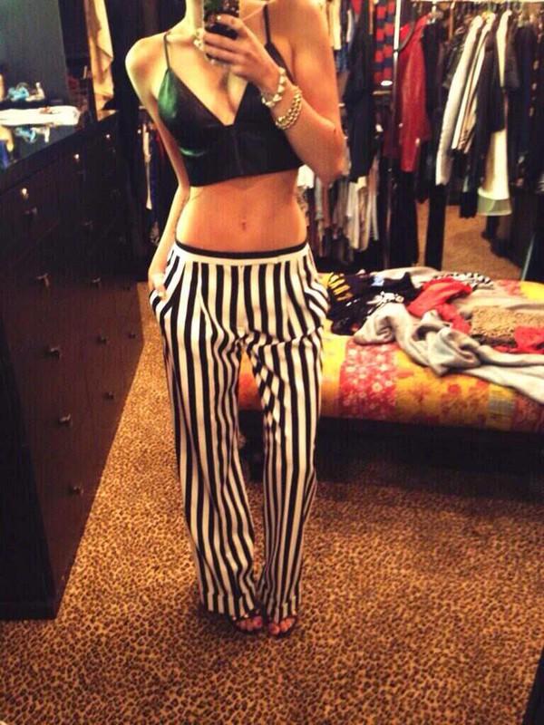 miley cyrus stripes pants white trousers black trousers white pants leather top bra bra monochrome bralette bralette striped pants