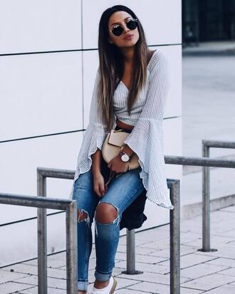 sunglasses black sunglasses shirt white shirt jeans blue jeans bag neutral bag shoes white shoes